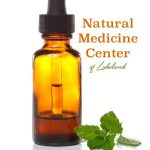 Natural Medicine Center of Lakeland logo with Medicine Dropper