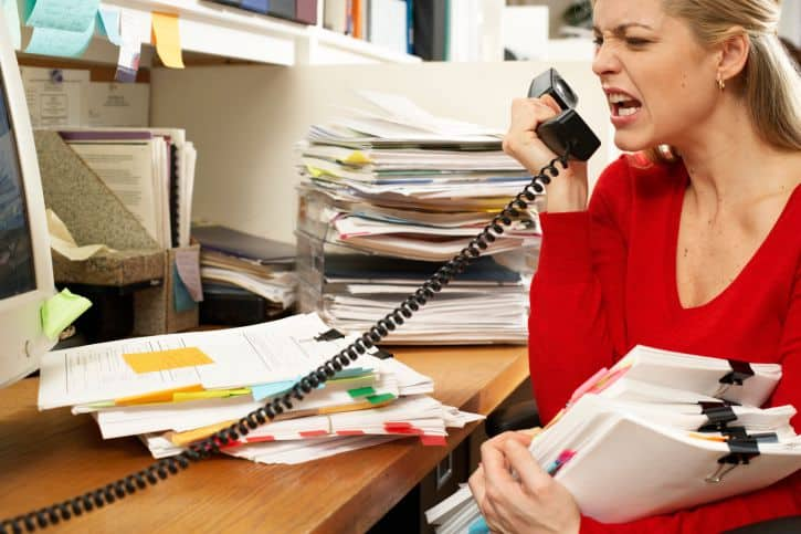 Woman in office yelling on phone